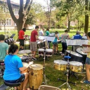 Truman Steel giving a concert on the Quad
